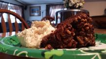 Chocolate Irish Whisky Cake served with sweetened whipped cream and nutmeg.