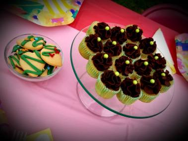 Vanilla mini cupcakes with chocolate ganache.